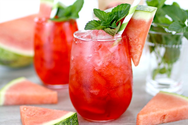watermelon vodka drink in a glass with fresh mint